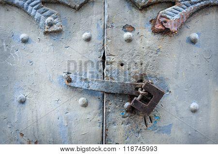 Black Metal Padlock On Green Wooden Old Garage Gates With Handle