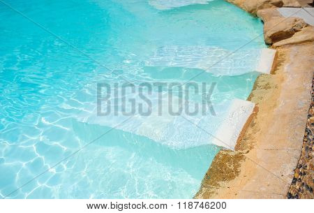 White Deck Chairs In The Pool