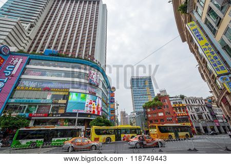 GUANGZHOU, CHINA - SEPTEMBER 20, 2014: Cars  on a downtown street in the main shopping district.