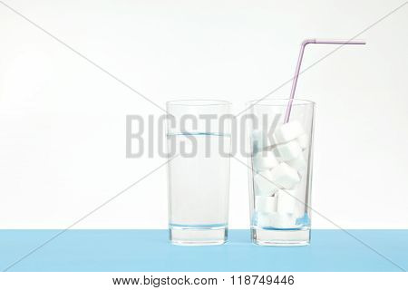 Glass of pure water against sugar, diabetes disease, sweet addiction white background