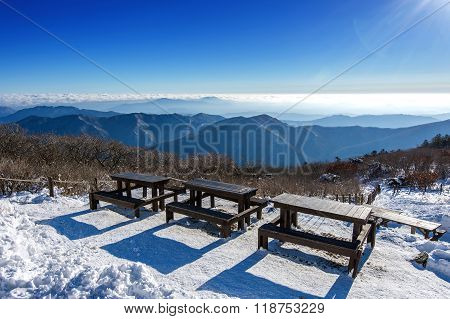 Wooden Picnic Tables With Benches In Winter,deogyusan Mountains, South Korea.