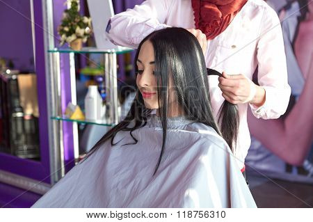 Hair stylist working on haircut for happy client