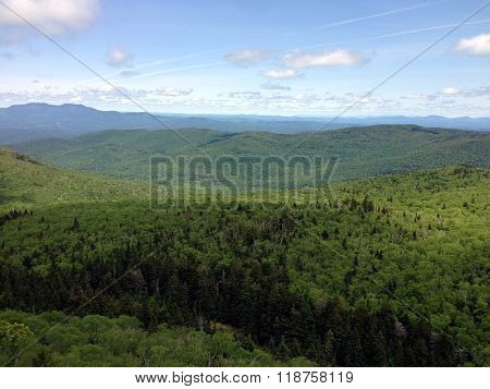 The Green Mountains of Vermont explode with green leaves in late spring.
