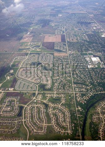 Patterns of the Chicago suburbs are revealed through the clouds. ** Note: Visible grain at 100%, best at smaller sizes