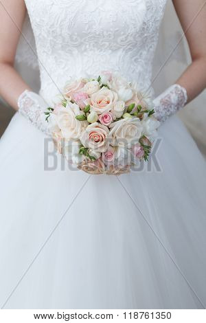Cream wedding bouquet of roses and freesias