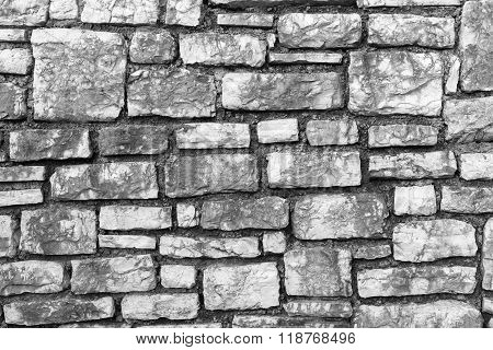 Channeled Textured Surface Of A Stone Wall