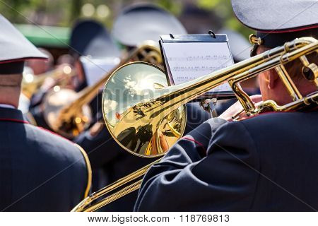Musician Of The Military Orchestra Playing On Gold Trombone