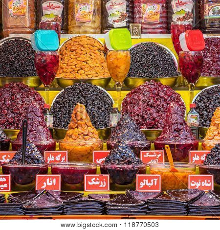 Tehran, Iran - November 30, 2015: Traditionally dried and processed sour plums, sour cherries and forest fruits for sale in Darband area of Tehran, Iran.