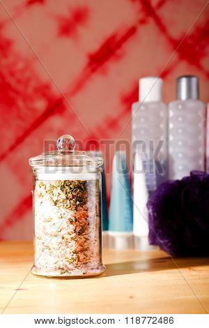Bath Salt In Glass Jar In Front Of Other Accessories