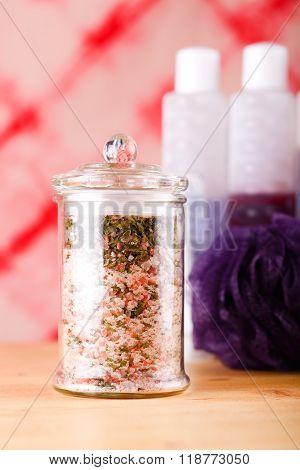 Glass Jar With Pink Bath Salt With Herbs