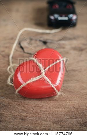 Heart Which Tied Up With Rope Is Towing By Sports Car