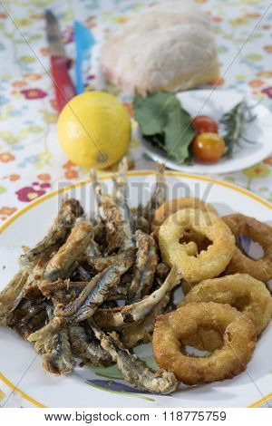 Battered And Fried Rings Of Squid And Anchovies