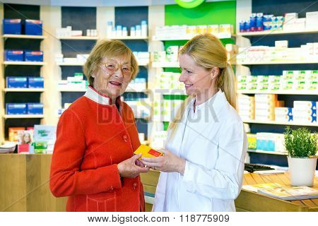 Pharmacist Giving Customer Prescription Drugs