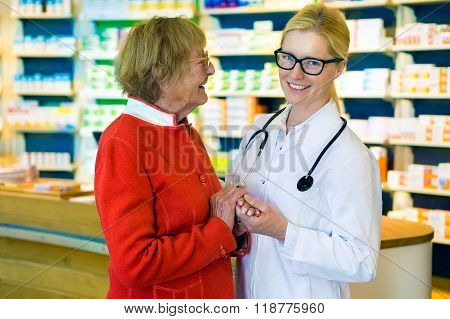 Laughing Doctor And Happy Patient In Pharmacy