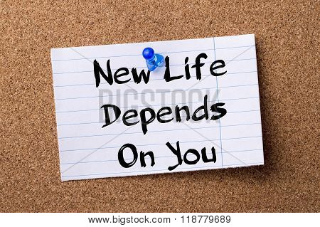 New Life Depends On You - Teared Note Paper Pinned On Bulletin Board