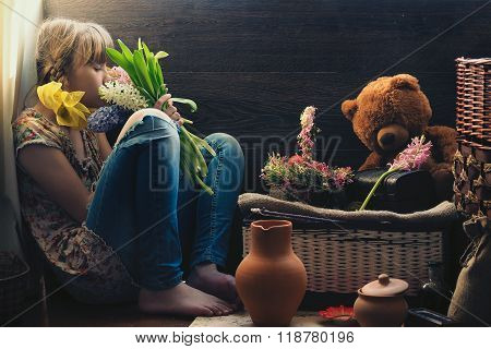 Teenage girl and a bouquet of spring flowers