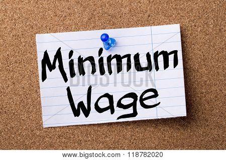 Minimum Wage - Teared Note Paper Pinned On Bulletin Board