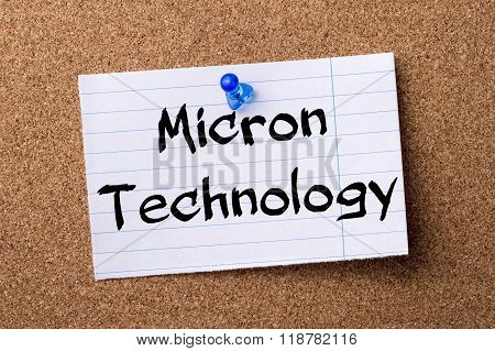 Micron Technology - Teared Note Paper Pinned On Bulletin Board