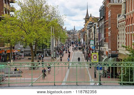 People In The Historic City Center Near The Building Of Railway Station In Haarlem, The Netherlands
