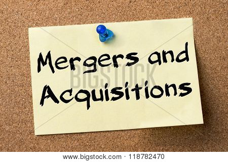 Mergers And Acquisitions - Adhesive Label Pinned On Bulletin Board