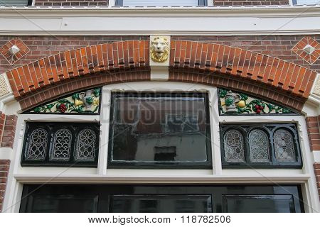 Upper Part Of Art Decoration Of The Old House Window In The Historic Centre Of Haarlem, The Netherla