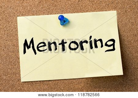 Mentoring - Adhesive Label Pinned On Bulletin Board