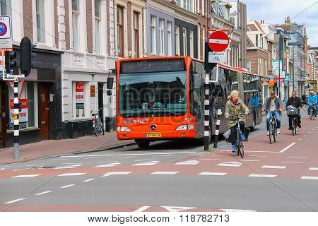 Riding A Bike People And Big Bus In The Historic Center Of Haarlem, The Netherlands