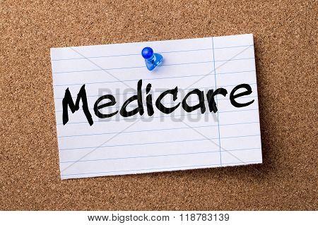 Medicare - Teared Note Paper Pinned On Bulletin Board