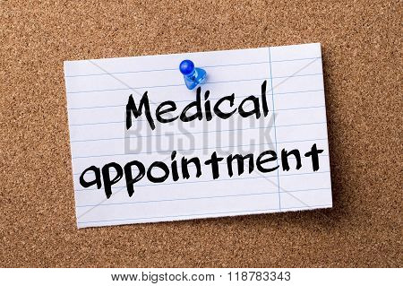 Medical Appointment - Teared Note Paper Pinned On Bulletin Board
