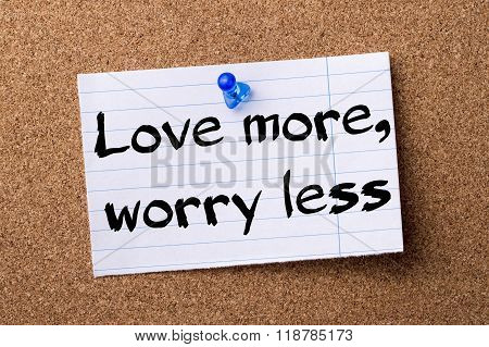 Love More, Worry Less - Teared Note Paper Pinned On Bulletin Board