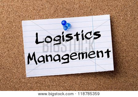 Logistics Management - Teared Note Paper Pinned On Bulletin Board