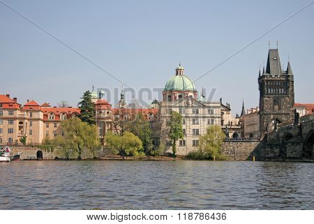 Prague, Czech Republic - April 24, 2010: River Vltava In Prague. Old Town Tower Of Charles Bridge An