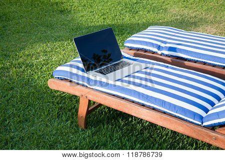 Open Laptop On Mat Deckchair
