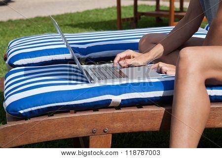 Woman Touching Laptop On Mat Deckchair