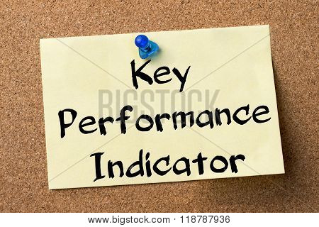Key Performance Indicator Kpi - Adhesive Label Pinned On Bulletin Board