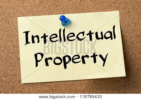 Intellectual Property - Adhesive Label Pinned On Bulletin Board