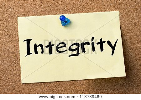 Integrity - Adhesive Label Pinned On Bulletin Board