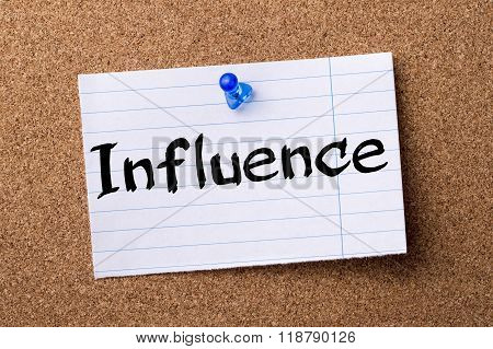 Influence - Teared Note Paper Pinned On Bulletin Board