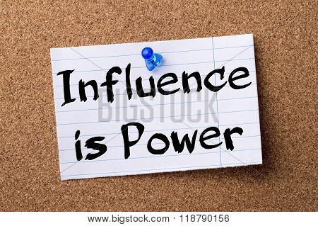 Influence Is Power - Teared Note Paper Pinned On Bulletin Board