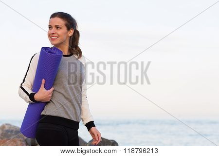 Sportive Woman Working Out By The Sea