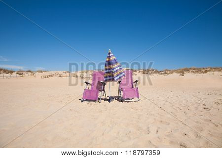 Two Lonely Chairs And Umbrella At Beach