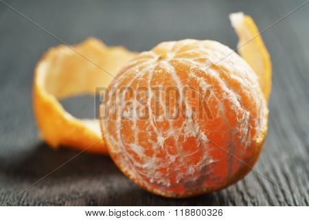ripe tangerine peeled on wood table