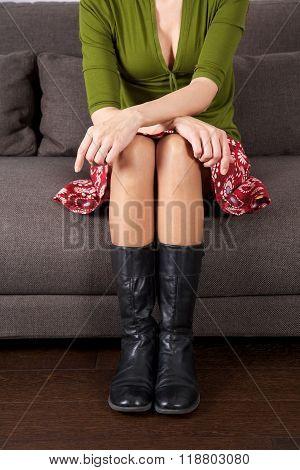 Sexy Woman Sitting On Sofa