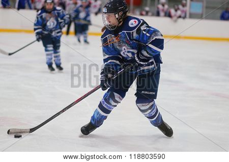 ST. PETERSBURG, RUSSIA - FEBRUARY 17, 2016: Anastasia Chistyakova of women's ice hockey team Dinamo Saint-Petersburg in the match against Biryusa Krasnoyarsk. Dinamo won the match 3-1