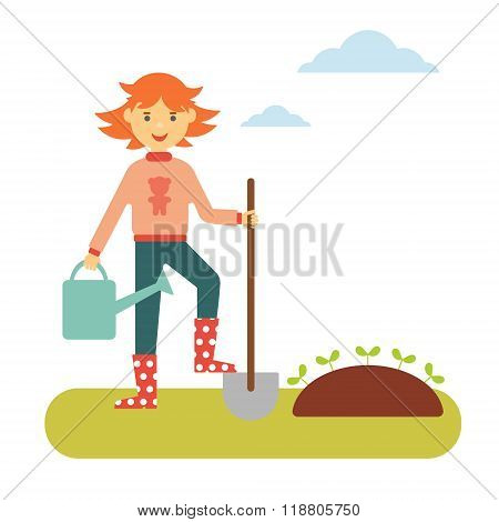 Red-haired girl with a shovel and a watering can makes planting