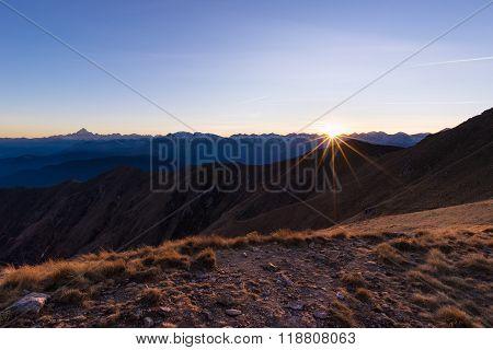 Mountain Range At Sunset, Backlight With Sunburst, Italian Alps