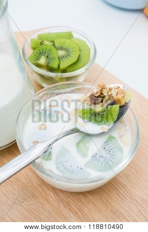 Breakfast, Eating Cereal, Pick Up Spoon, Scoop Cereal With Fresh Kiwis And Milk