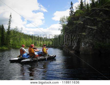 KOLA PENINSULA RUSSIA - AUGUST 11 - Team of men on an inflatable catamaran at rough river in Kola Peninsula on August 11 2008.