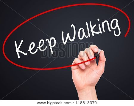 Man Hand Writing Keep Walking With Black Marker On Visual Screen