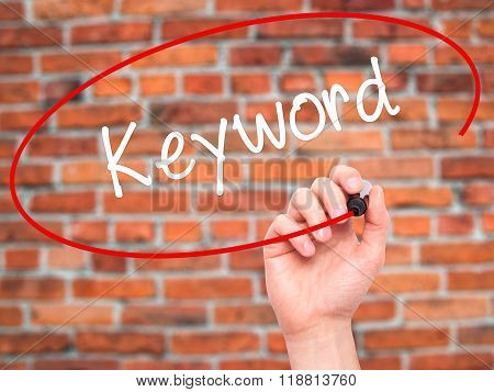 Man Hand Writing Keyword With Black Marker On Visual Screen